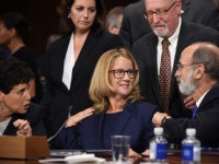 Christine Blasey Ford, the woman accusing Supreme Court nominee Brett Kavanaugh of sexually assaulting her at a party 36 years ago, chats with her attorneys as she testifies before the US Senate Judiciary Committee on Capitol Hill in Washington, DC, September 27, 2018. (Photo by SAUL LOEB / POOL / …