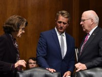 Senate Judiciary Committee members Dianne Feinstein (D-CA) (L), Jeff Flake (R-AZ) (C), and Patrick Leahy (D-VT) look on during a hearing on Capitol Hill in Washington, DC on September 28, 2018, on the nomination of Brett M. Kavanaugh to be an associate justice of the Supreme Court of the United …