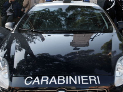 ROME, ITALY - DECEMBER 23: Carabiniere (Italian Special Police) stand in front of the Swiss Embassy after a parcel bomb exploded this morning on December 23, 2010 in Rome, Italy. A 53-year-old Swiss national seriously injured his hands as he opened the package. (Photo by Franco Origlia/Getty Images)