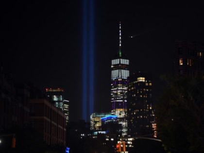The Tribute in Light, lit to commemorate the 18th anniversary of September 11, 2001 attacks in New York City, is seen next to the One World Trade Center on September 10, 2019 in New York City. (Photo by Johannes EISELE / AFP) (Photo credit should read JOHANNES EISELE/AFP/Getty Images)