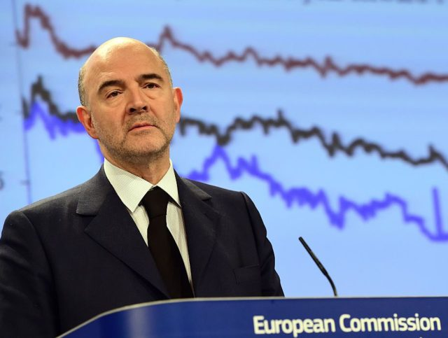 European Commissioner for Economic and Financial Affairs, Taxation and Customs, Pierre Moscovici unveils the European economic forecast, Winter 2015, at the European Commission headquarters in Brussels, on February 5, 2015. AFP PHOTO/Emmanuel Dunand (Photo credit should read EMMANUEL DUNAND/AFP/Getty Images)