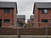 GLASGOW, SCOTLAND - OCTOBER 06: New housing under construction in the Govan area on October 6, 2015 in Glasgow, Scotland. Recent reports indicate that affordable housing in Scotland needs to be double what is currently being built at the moment. At least 12,000 homes need to be built every year …