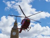 A London air ambulance takes off from Parliament Square in front of the Houses of Parliament after it arrived earlier as part of the response to an incident in which a man was injured after falling 15 feet at nearby Westminster Bridge in London on May 3, 2016. The man …