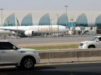 A picture taken on August 10, 2017, shows an Emirates airline Boeing 777 parked on the tarmac at Dubai airport. The airlines confirmed it would sponsor the shirts of Qatar-owned Paris Saint-Germain until 2019, despite a regional crisis which has seen the UAE cut ties with Doha. / AFP PHOTO …