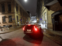 Police arrive after a synagogue was attacked in a failed arson attempt in Gothenburg, Sweden, late December 9, 2017. No one was injured but Jewish community members told local media the synagogue was attacked by a group of masked men who threw multiple burning objects. / AFP PHOTO / TT …