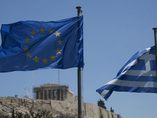 A Greek national flag and a European Union flag flutter in the wind as the Parthenon is seen on the Acropolis archaeological site in Athens, Greece. The Greek government borrowed billions from the EU as part of three large bailout programs that Athens has now completed. File Photo by Dimitris …