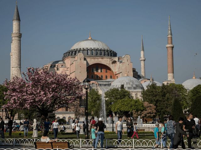 People Walk in front of the Hagia Sofia in Sultanahmet on April 24, 2018 in Istanbul, Turkey. As peak tourism season approaches early booking figures and foreign demand suggest Turkey will reach a record of 40 million visitors in 2018. The tourism sector suffered big losses in 2016 due to …