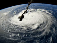In this NASA handout image taken by Astronaut Ricky Arnold, Hurricane Florence gains strength in the Atlantic Ocean as it moves west, seen from the International Space Station on September 10, 2018. Weather predictions say the storm will likely hit the U.S. East Coast as early as Thursday, September 13 …