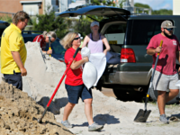 Residents of the Isle of Palms, S.C., fill sand bags at the Isle of Palms municipal lot where the city was giving away free sand in preparation for Hurricane Florence at the Isle of Palms S.C., Monday, Sept. 10, 2018.
