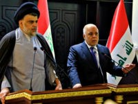 In this photo provided by the Iraqi government, Iraqi Prime Minister Haider al-Abadi, right, and Shiite cleric Muqtada al-Sadr hold a press conference in the heavily fortified Green Zone in Baghdad, Iraq, early Sunday, May 20, 2018. Shiite cleric Muqtada al-Sadr, whose coalition won the largest number of seats in …