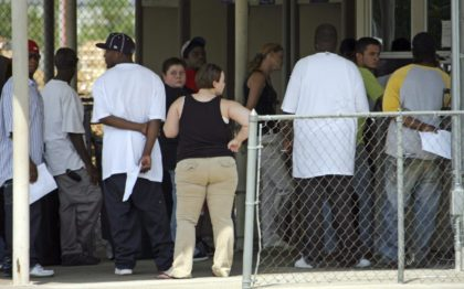 Howard Industries job applicants gather at the plant in Laurel, Miss., Wednesday, Aug. 27, 2008. Several hundred applicants gathered at the plant Wednesday seeking employment following Monday's roundup of suspected illegal immigrants working at the electronics plant.