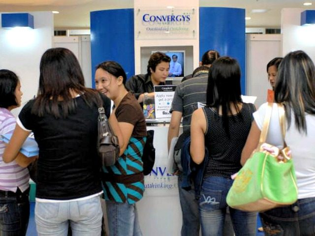 Manila, PHILIPPINES: Applicants line up for potential jobs in call centers at a national call center exposition in Manila, 10 July 2007. The exposition opened on 10 July and highlights the growth of the call center and other forms of business process outsourcing (BPOs) in the country. Industry leaders have …
