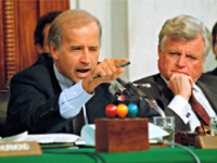 In this Oct. 12, 1991, file photo, then-Senate Judiciary Committee Chairman Sen. Joe Biden, D-Del., points angrily at Clarence Thomas during comments at the end of hearings on Thomas' nomination to the Supreme Court on Capitol Hill. Sen. Edward Kennedy, D-Mass., watches at right.