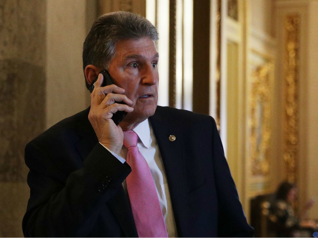 U.S. Sen. Joe Manchin (D-WV) talks on his phone at the Capitol December 1, 2017 in Washington, DC. Senate GOPs indicate that they have enough votes to pass the tax reform bill. (Photo by Alex Wong/Getty Images)