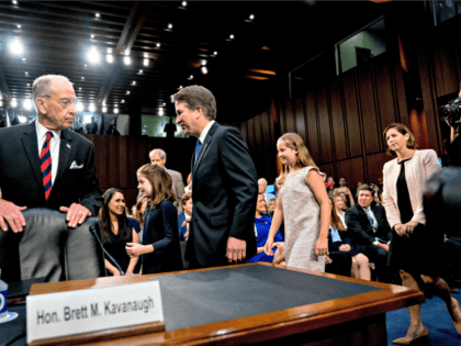 President Donald Trump's Supreme Court nominee, Brett Kavanaugh, center, a federal appeals court judge, accompanied by Senate Judiciary Chairman Chuck Grassley, R-Iowa, left, arrives with his family for a Senate Judiciary Committee hearing on Capitol Hill in Washington, Tuesday, Sept. 4, 2018, to begin his confirmation to replace retired Justice …