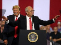 U.S. president Donald Trump (L) looks on as republican candidate for U.S. Senate, U.S. Rep. Kevin Cramer, (R-ND) speaks to supporters during a campaign rally at Scheels Arena on June 27, 2018 in Fargo, North Dakota. President Trump held a campaign style 'Make America Great Again' rally in Fargo, North …