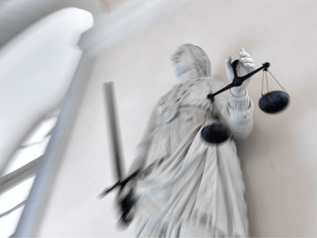 A picture taken on September 19, 2017 at Rennes' courthouse shows a statue of the goddess of Justice balancing the scales. / AFP PHOTO / LOIC VENANCE (Photo credit should read LOIC VENANCE/AFP/Getty Images)
