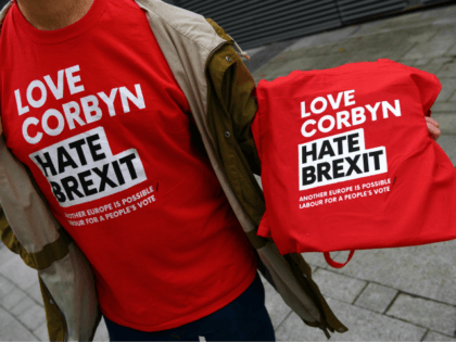 T-shirts promoting a pro-Corbyn, anti-Brexit stance is seen on sale outside the Labour Party Conference in Liverpool, north west England on September 23, 2018, the official opening day of the annual Labour Party Conference. - Britain's Labour Party kicks off its annual conference on Sunday hoping to prove it is …