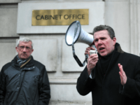 Mark Serwotka, General Secretary of the Public and Commercial Services union (PCS), speaks during a rally outside the Cabinet Office in central London on April 5, 2013 as they strike for half a day in a row over pay, pensions and terms and condition. AFP PHOTO/CARL COURT (Photo credit should …