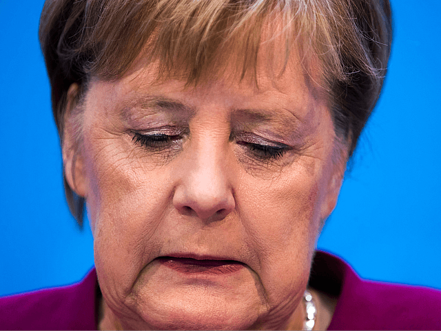 Merkel to give up leadership of party but remain chancellor