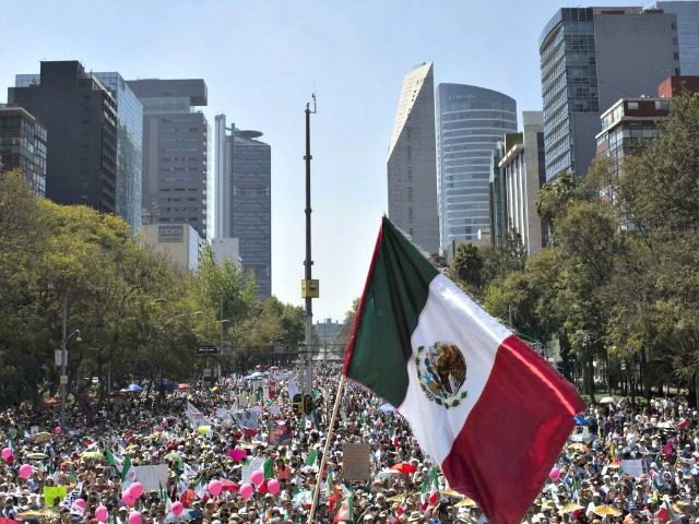 Demonstrators opposed to the policies of President Trump and Mexican President Enrique Peña Nieto march to the Plaza Angel Independencia in Mexico City on Feb. 12.