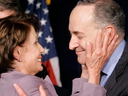 House Minority Leader Nancy Pelosi, D-Calif., hugs Sen. Chuck Schumer, D-N.Y., at the Democratic Congressional Campaign Committee victory celebration in Washington, Wednesday, Nov. 8, 2006. (AP Photo/Gerald Herbert)