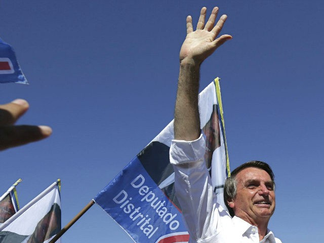 National Social Liberal Party presidential candidate Jair Bolsonaro greets supporters during a campaign rally in Brasilia's Ceilandia neighborhood, Brazil, Wednesday, Sept. 5, 2018. Brazilians go to the polls on October 7 to cast their vote for a new president. (AP Photo/Eraldo Peres)