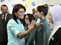 A picture taken on May 21, 2017 shows US Ambassador to the UN Nikki Haley (L) meeting with Syrian refugee students in the Jordanian capital Amman.