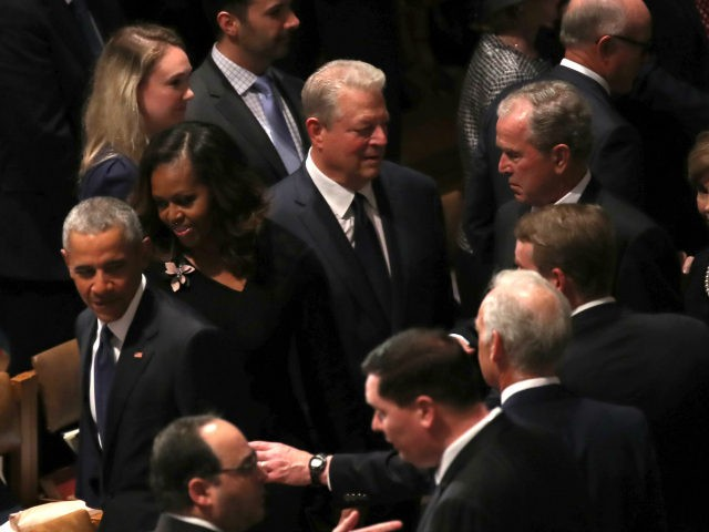 Former U.S. President Barack Obama, Michelle Obama, former U.S. Vice President Al Gore, and former U.S. President George W. Bush arrive for the funeral service for U.S. Sen. John McCain at the National Cathedral on September 1, 2018 in Washington, DC. The late senator died August 25 at the age …
