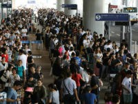 Passengers stranded overnight at the Kansai International Airport due to typhoon Jebi queue for buses that will transport them from the airport in Izumisano city, Osaka prefecture on September 5, 2018. - A major airport that was cut off when a huge typhoon smashed through its sole access road was …