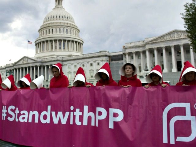 Supporters of Planned Parenthood dressed as characters from The Handmaid's Tale protest last June outside the Capitol against Senate Republicans' health care bill.