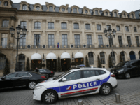 A police car drives past the Ritz hotel in Paris, Thursday, Jan. 11, 2018. Paris police have recovered some jewels stolen from the Ritz Hotel in a multimillion-euro robbery attempt, but are still searching Thursday for two thieves and the rest of the missing luxury merchandise. (AP Photo/Michel Euler)