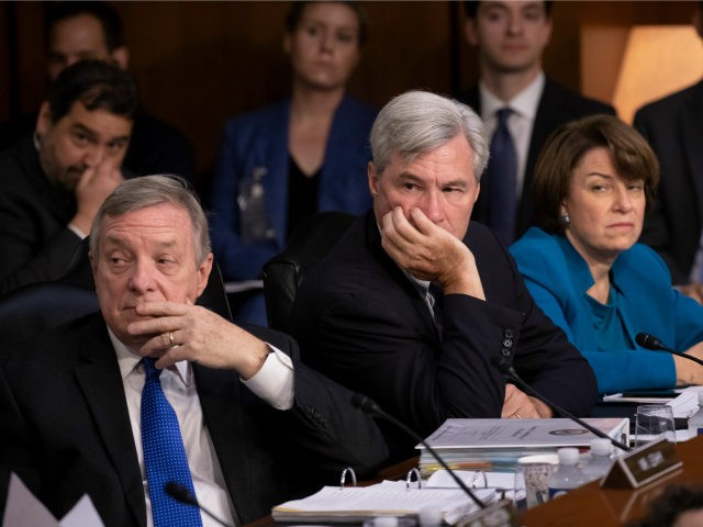 Democrats on the Senate Judiciary Committee, from left, Sen. Dick Durbin, D-Ill., Sen. Sheldon Whitehouse, D-R.I., and Sen. Amy Klobuchar, D-Minn., and other minority members, appeal to Chairman Chuck Grassley, R-Iowa, to delay the confirmation hearing of President Donald Trump's Supreme Court nominee, Brett Kavanaugh, on Capitol Hill in Washington, …