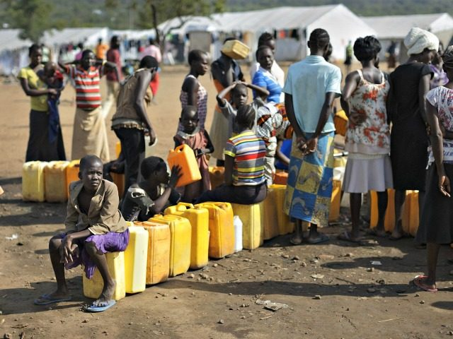 Illustrative: South Sudanese refugees line up to fill their plastic containers with water from a tap at the Imvepi reception center, where newly arrived refugees are processed before being allocated plots of land in nearby Bidi Bidi refugee settlement, in northern Uganda,, June 9, 2017.