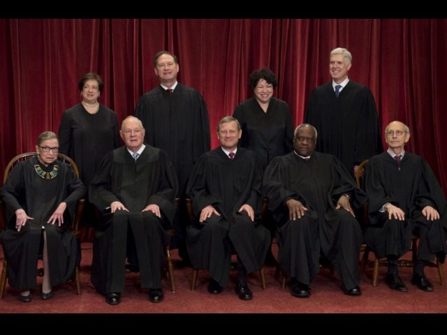 The US Supreme Court justices posing for a photo in Washington, DC, June 1, 2017.