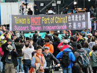 Pro-independence supporters carry a banner shouting that Taiwan is not part of China outside of the Democratic Progressive Party, or DPP, presidential campaign headquarters Saturday, Jan. 16, 2016, in Taipei, Taiwan. Taiwanese turned out to vote for a new president Saturday, with the China-friendly Nationalist Party likely to lose power …