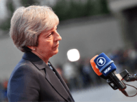 Britain's Prime Minister Theresa May speaks to journalists as she arrives at the Felsenreitschule prior to their informal dinner as part of the EU Informal Summit of Heads of State or Government in Salzburg, Austria on September 19, 2018. (Photo by JOE KLAMAR / AFP) (Photo credit should read JOE …
