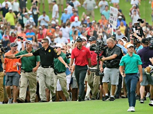 Tiger Woods, center, and Rory McIlroy, right, make their way down the 18th fairway during the final round of the Tour Championsh