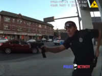 WATCH: Cop Shot During Gunfight Puts Another Magazine in Pistol, Calls His Own Ambulance