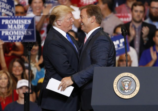 President Donald Trump, left, embraces Sen. Dean Heller, R-Nev., during a campaign rally Thursday, Sept. 20, 2018, in Las Vegas.