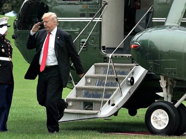 WASHINGTON, DC - SEPTEMBER 27: U.S. President Donald Trump salutes to a Marine as he steps off the Marine One after he landed at the South Lawn of the White House September 27, 2018 in Washington, DC. President Trump has returned from the United Nations General Assembly meeting.