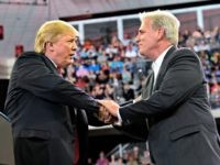 President Donald Trump, left, shakes hands with House Majority Leader Kevin McCarthy of Calif., right, during a rally at AMSOIL Arena in Duluth, Minn., Wednesday, June 20, 2018.