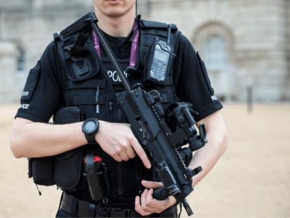 LONDON, ENGLAND - SEPTEMBER 16: An armed police officer patrols in Horse Guards Parade on September 16, 2017 in London, England. An 18-year-old man has been arrested in Dover in connection with yesterday's terror attack on Parsons Green station in which 30 people were injured. The UK terror threat level …