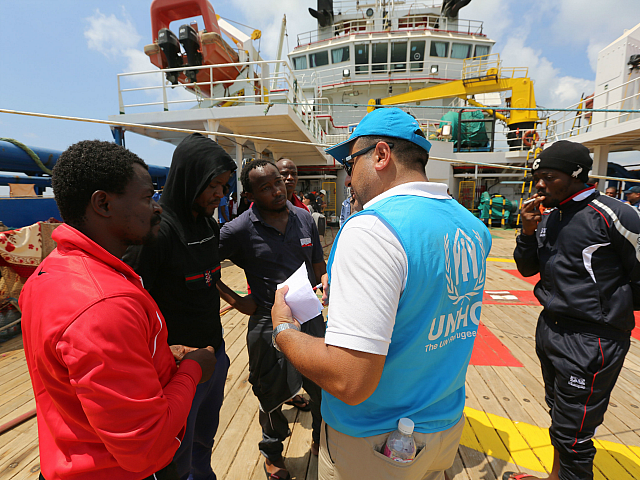 African migrant talk to an UN Refugee Agency (UNHCR) official aboard the ship 'Sarost 5' docked in the southern Tunisian port of Zarzis on August 1, 2018. - A Tunisian commercial ship that had rescued 40 migrants including two pregnant women docked today at the southern Tunisian port after more …