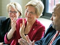 Warren Fundraising In this March 3, 2017, photo, Sen. Elizabeth Warren, D-Mass., middle, applauds during a small business roundtable discussion, in Lawrence, Mass. Warren regularly critiques an economic system she says is rigged against the little guy. Fueling that message is a voracious fundraising machine that's turned the Massachusetts Democrat …