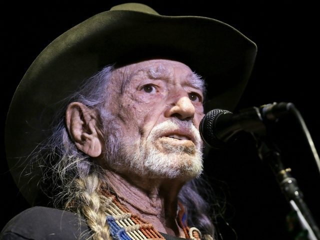 FILE - In this Jan. 7, 2017 file photo, Willie Nelson performs in Nashville, Tenn. Nelson has postponed three California shows because of illness. Publicist Elaine Schock tells The Associated Press that Nelson will have to miss his three-night stint that had been scheduled for Monday Feb. 6, 2017, Tuesday, …