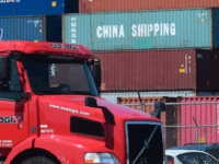 A container delivery truck drives past stacked piles of shipping containers at the Port of Long Beach in Long Beach, California on July 6, 2018, including one from China Shipping, a conglomerate under the direct administration of China's State Council. - The twin ports of Long Beach and Los Angeles …