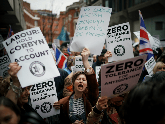 Campaigners from the Campaign Against Antisemitism demonstrate and listen to speakers outside the Labour Party headquarters on April 8, 2018 in London, England. Protesters are calling on Labour's hierarchy to 'hold Jeremy Corbyn to account' after claims that he and the party are not doing enough to root out anti-Jewish …