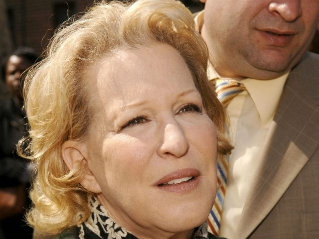 Bette Midler poses while helping to plant trees at the Martin Luther King Jr. Housing Campus in Harlem for Earth Day on April 22, 2008 in New York City. (Photo by Donna Ward/Getty Images)