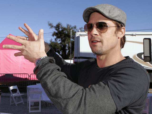Actor Brad Pitt talks about his plan to build homes in the Lower 9th Ward in New Orleans, Monday, Dec. 3, 2007. Pitt is launching his latest project to build affordable, environmentally friendly homes in the area devastated by Hurricane Katrina. (AP Photo/Bill Haber)